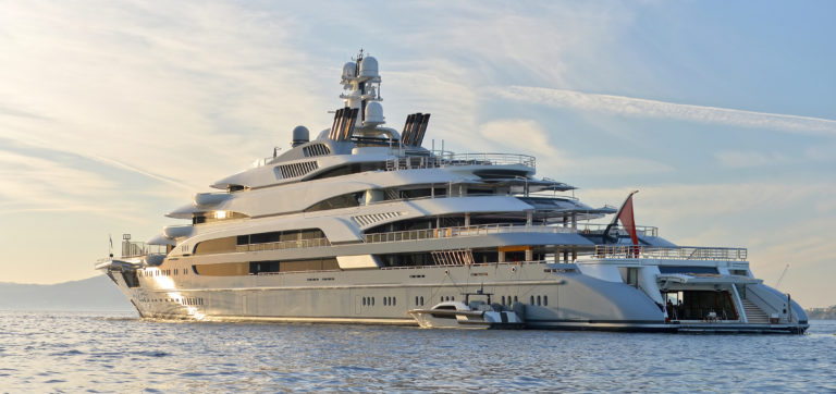 Superyacht at anchor with January yacht jobs